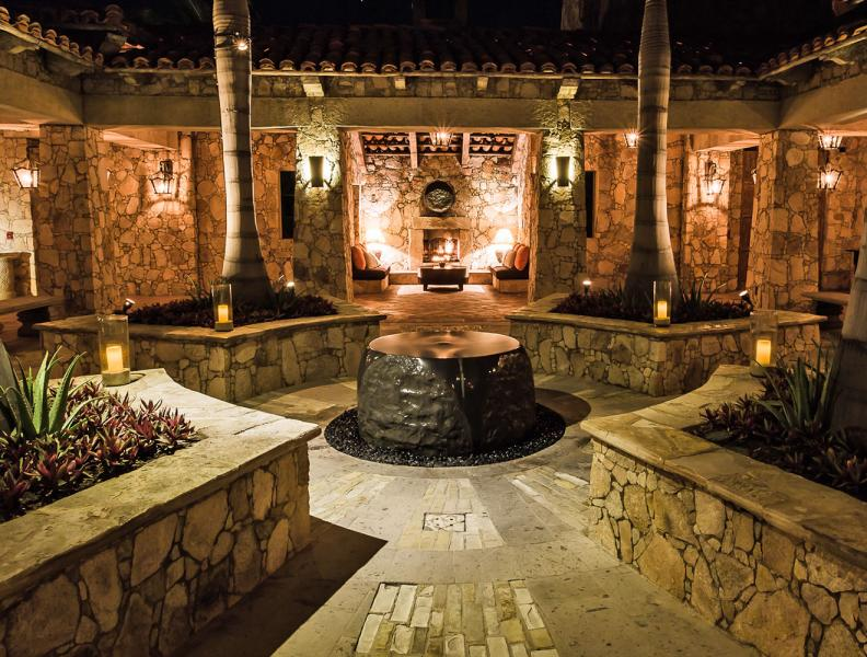 Hotel courtyard with water feature at night