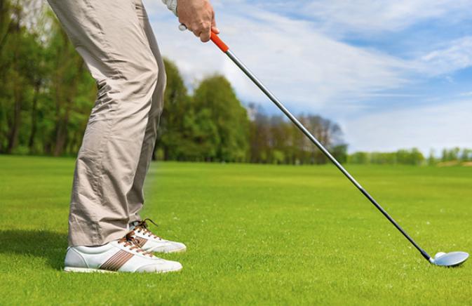 Golfer setting up a shot